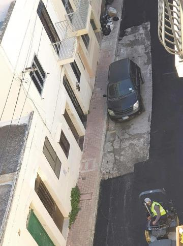 The parked car surrounded by freshly-laid tarmac in St Paul's Bay, which fuelled controversy on Facebook and raised questions on the manner in which the works were being done.