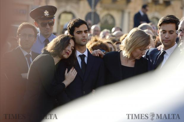 Family members of blogger Daphne Caruana Galizia attend her funeral ceremony at Mosta Dome, on November 3. Photo: Matthew Mirabelli