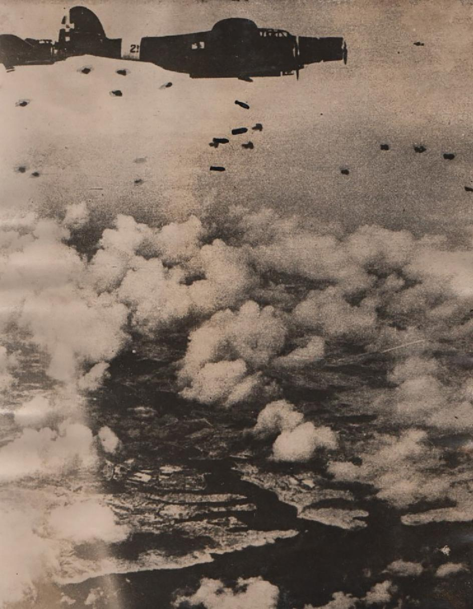 Italian Air Force bombers dropping bombs over Malta.