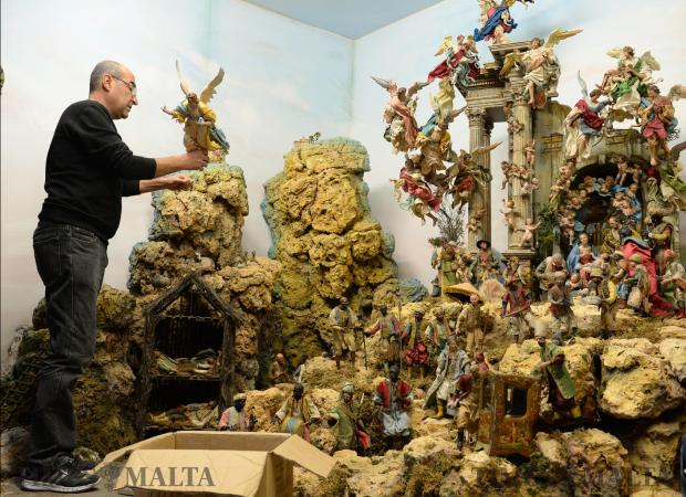 Traditional Neapolitan figures are fixed in place at a collection of 18th century crèche figurines on display at the Mdina Cathedral on November 29. Photo: Matthew Mirabelli