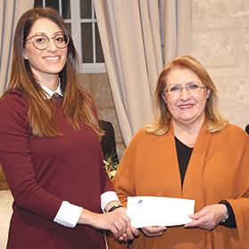 Liana Cachia, Thomas Smith marketing and human resources director, presenting the funds to President of Malta Marie-Louise Coleiro Preca.