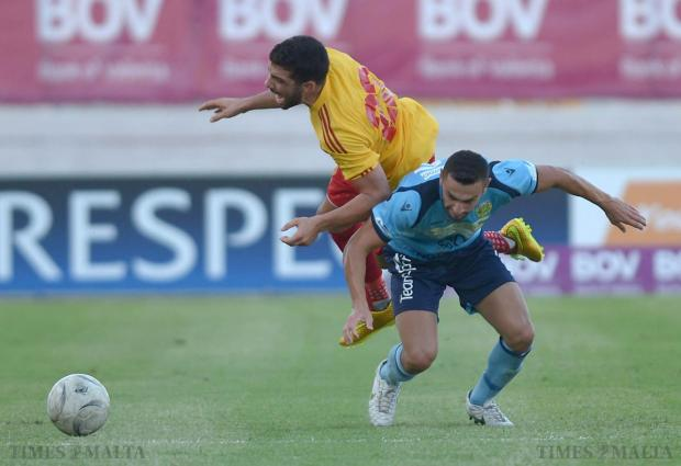 Birkirkara's Zach Muscat rolls over the back of Zebbug's Matthew Gauci during their Premier League match at the National Stadium in Ta'Qali on August 23. Photo: Matthew Mirabelli