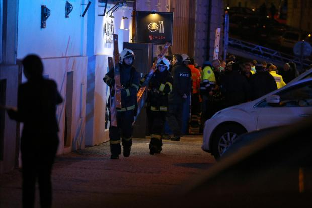 Firefighters work at the scene of a fire at a hotel in Prague.