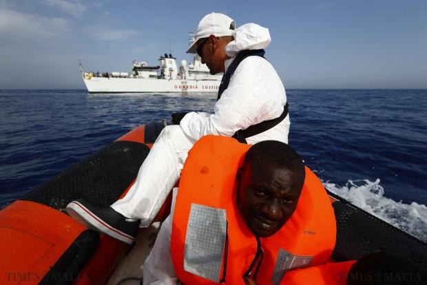 A Migrant Offshore Aid Station (MOAS) RHIB (rigid hulled inflatable boat) carrying rescued migrants approaches the Italian Coast Guard Vessel Oreste Corsi off the coast of Libya on August 3. 118 migrants were rescued by the MOAS ship MV Phoenix from a rubber dinghy some 32 kilometres off the coast of Libya on Monday morning. The Phoenix, manned by personnel from international non-governmental organisations Medecins san Frontiere (MSF) and MOAS, is the first privately funded vessel to operate in the Mediterranean. Photo: Darrin Zammit Lupi