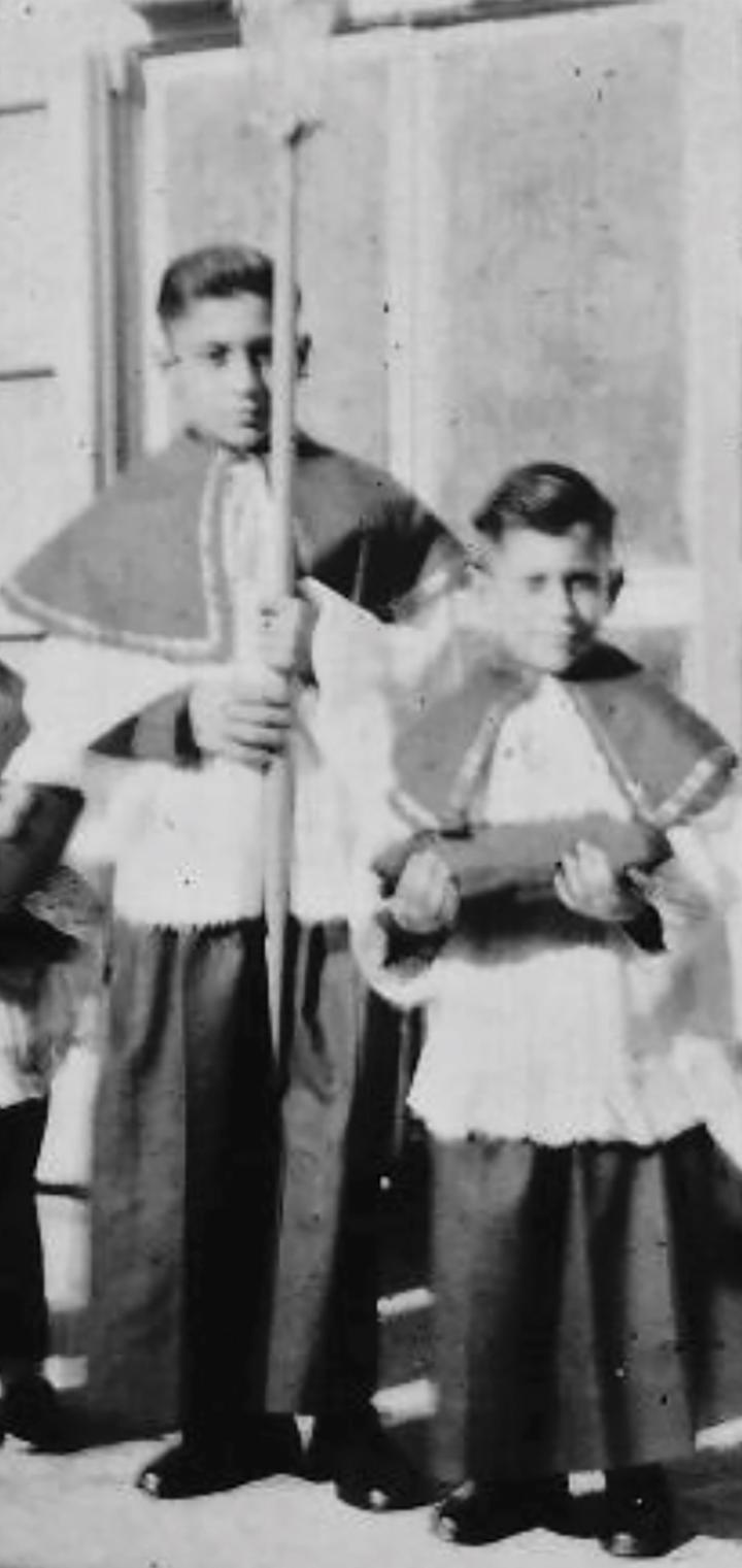 The author, aged 12, holding a lantern as part of the procession.