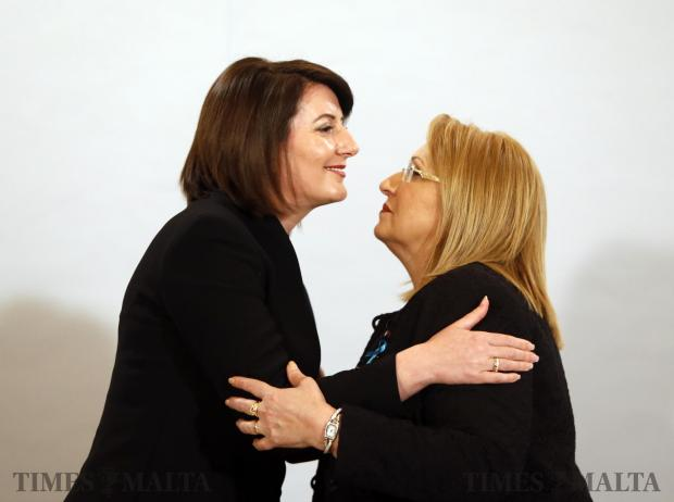 "President of Kosovo Atifete Jahjaga (left)and Maltese President Marie-Louise Coleiro Preca embrace after addressing the forum 'Sexual Violence in Conflict and Beyond"" at Verdala Palace on March 28. Photo: Darrin Zammit Lupi"