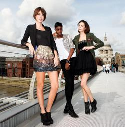 Britain's Next Top Model semi-finalists: From left, Tiffany Pisani, Alisha White and Joy McLaren, on Millennium Bridge, London. Photo: Katie Collins/PA Wire