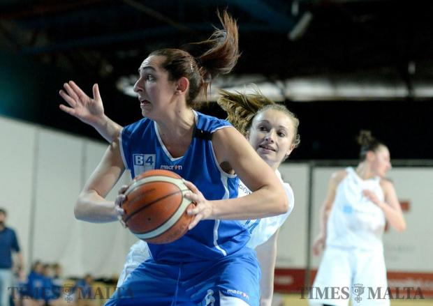Starlites (white) play Gzira Athleta (blue) in the Louis Borg Cup basketball final at the Ta'Qali Pavilion on February 12. Starlites won the match 71-65 but their efforts were not enough to cancel the 34-42 loss from the series. Photo: Photo: Matthew Mirabelli