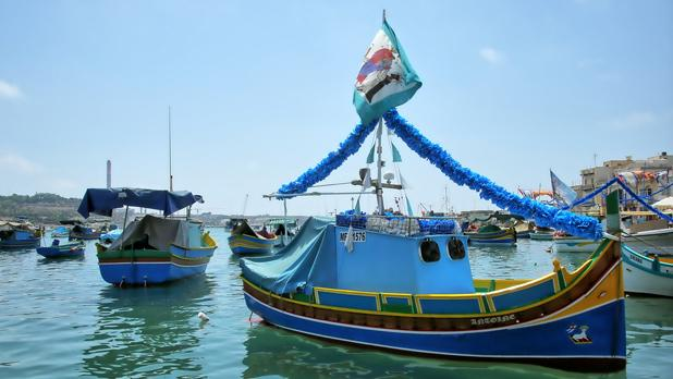 Boat in Marsaxlokk Harbour decorated for the local feast. Photo: Charles Portelli