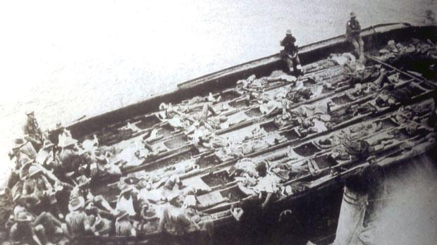 Wounded men being taken by barge to a hospital ship at Gallipoli.