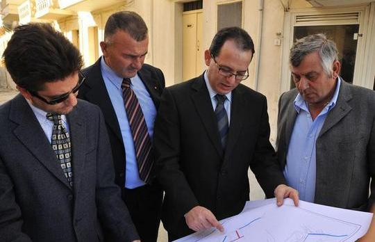 Parliamentary Secretary Chris Said is seen during a visit to road works at Marsalforn, one of the localities which will get its own administrative committees.