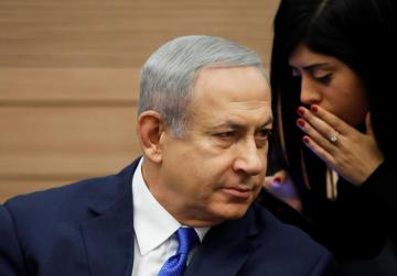 Israel's Netanyahu avoids early elections for now after minister's about-face