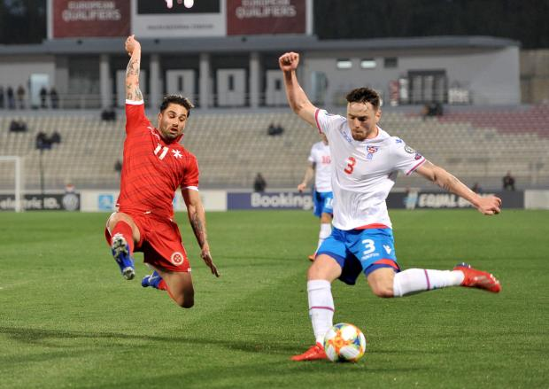 Malta's Rowen Muscat flies in to a tackle. Photo: Chris Sant Fournier