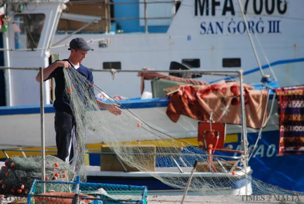 A fisherman arranges his nets in Marsaxlokk on January 13. Photo: Mark Zammit Cordina