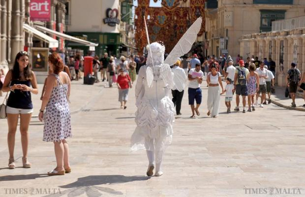 A busker fairy makes her way down Republic Street to her busking spot on July 29. Photo: Chris Sant Fournier