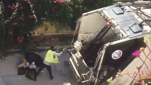 A still from footage showing a waste collection employee dumping white and black bags in the same truck during Monday's collection in St Paul's Bay.