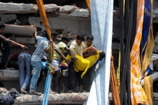 Rescue workers try rescue trapped garment workers in the Rana plaza building in 2013.