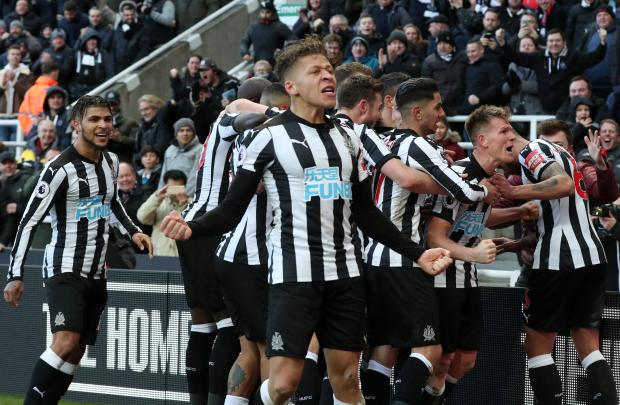Newcastle United's Matt Ritchie celebrates scoring their first goal with Dwight Gayle and team mates.