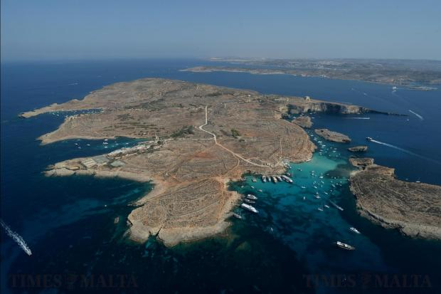 The clear blue waters around the Blue Lagoon in Comino are seen from the air on August 9. Photo: Matthew Mirabelli