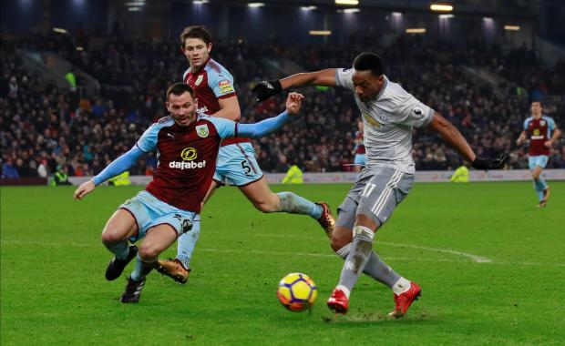 Anthony Martial shoots at goal against Burnley.