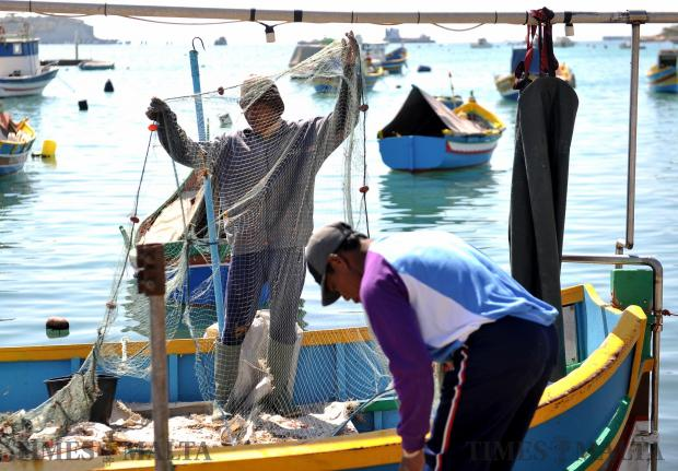 Fishermen prepare their nets for the next fishing trip at Marsaxlokk on March 28. Photo: Chris Sant Fournier