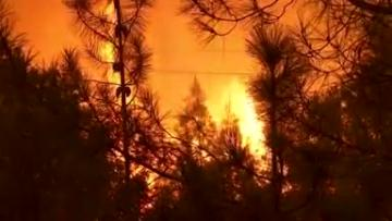Watch: California wildfire spreads, killing six and destroying more homes