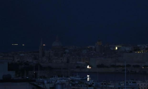 Valletta is seen in darkness during a nationwide power outage on August 12. A fault in one of the generating units at the Delimara power station and an explosion at the same time in an electricity distribution centre in Marsa caused a nationwide power outage lasting several hours on Tuesday evening. Photo: Darrin Zammit Lupi