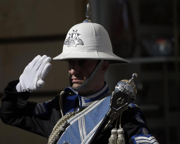 A Police officer salutes during a Police Day ceremony in Valletta on July 12. Photo: Mark Zammit Cordina