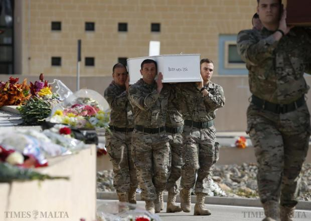 Armed Forces of Malta soldiers carry coffins with the bodies of migrants to an inter-faith burial service at Mater Dei Hospital in Tal-Qroqq, on April 23. European Union leaders who decided last year to halt the rescue of migrants trying to cross the Mediterranean reversed their decision at a summit hastily convened after nearly 2,000 people died at sea. Public outrage over the deaths peaked this week after up to 900 migrants died when their boat sank on its way to Europe from Libya. Photo: Darrin Zammit Lupi