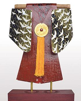 Birza's kimonos are made from found objects and lead sheets.