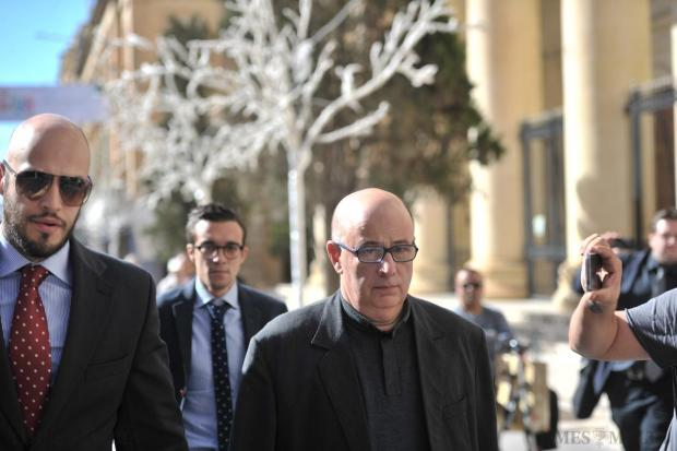 Fr Charles Fenech, who faces charges of sexual abuse, arrives in court on November 19 for an unrelated case. Photo: Jason Borg