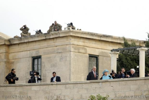 Overlooked by Armed Forces of Malta snipers, Britain's Queen Elizabeth and Prince Philip look down from bastions towards Grand Harbour during their visit to Heritage Malta at Villa Bighi in Kalkara, on November 28. Photo: Darrin Zammit Lupi