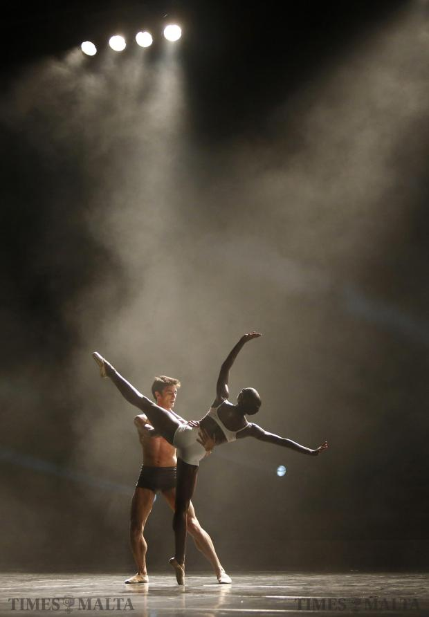 """Albanian dancer Alvaro Dule (left) and American dancer Cira Robinson perform in """"Just Dance"""", choreographed by American Antonia Franceschi and featuring dancers from The Royal Ballet, Rambert, Ballet Black and Random Dance, at Pjazza Teatru Rjal in Valletta on August 9. Photo: Darrin Zammit Lupi"""
