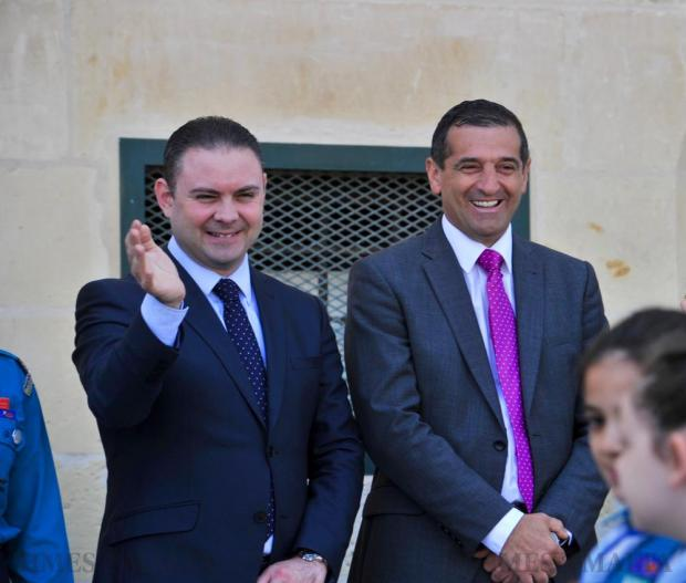 Justice Minister Owen Bonnici and Parliamentary Secretary for Sports Chris Agius wave during the Annual Scout Parade held at Valletta on April 17. Photo: Steve Zammit Lupi