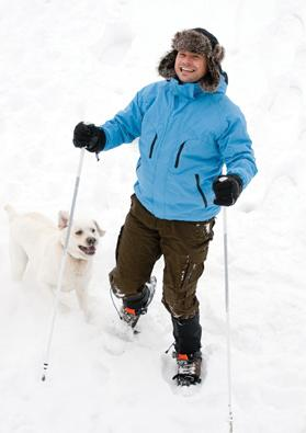Snowshoeing with a dog for company.