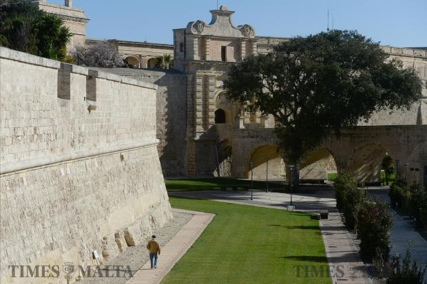 A man walks along the path in the ditch outside the walls of Mdina on February 7. Photo: Matthew Mirabelli