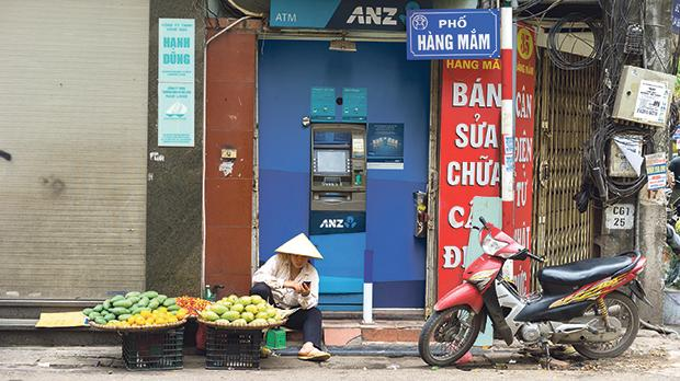 Vendor sales fruit in Hang Mam street, Hanoi.