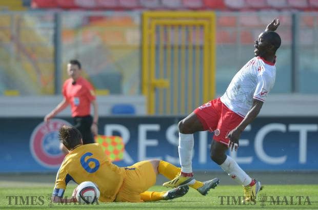 Malta's Alfred Effiong (right) is denied the ball by Moldova's Alexandru Epureanu during an International friendly match at the National Stadium in Ta'Qali on March 24. Photo: Matthew Mirabelli