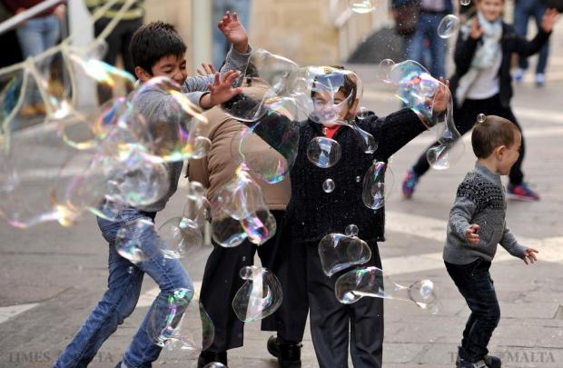 Children could not contain their excitement as they chased each other across Valletta's Republic Street, bursting soap bubbles a street artist was creating to the delight of passers-by on November 29. Photo: Chris Sant Fournier