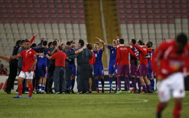 Croatia's players and team officials celebrate qualifying for the Euro 2016 finals after defeating Malta 1-0 during their Euro 2016 Group H qualification soccer match at the National Stadium in Ta' Qali on October 13. Photo: Darrin Zammit Lupi