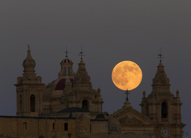 The supermoon rises over St Paul's Cathedral in Mdina on August 10. The astronomical event occurs when the moon is closest to Earth in its orbit, making it appear much larger and brighter than usual. Sunday's supermoon was the second of three spectacularly bright moons this year. Having three in such close proximity is very rare and will not happen again until 2034. Photo: Darrin Zammit Lupi