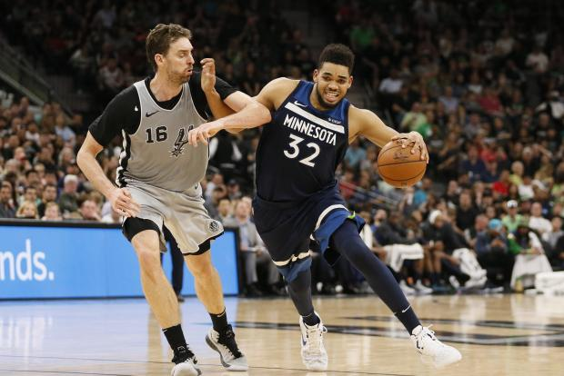 Minnesota Timberwolves center Karl-Anthony Towns (32) drives to the basket against San Antonio Spurs center Pau Gasol (16) during the second half at AT&T Center. Photo Credit: Soobum Im-USA TODAY Sports