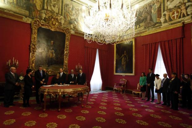 Carmelo Abela (3rd left) is sworn in as Minister of Home Affairs at the Palace in Valletta on December 9, after his predecessor Manuel Mallia was sacked by the Prime Minister. Photo: Darrin Zammit Lupi