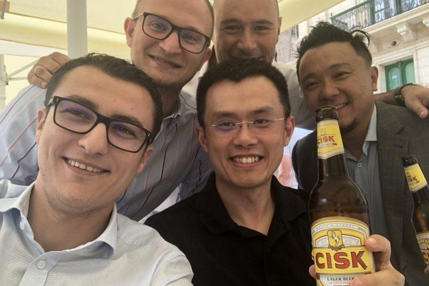 Cheers: Binance CEO Zhao poses for a photo in Malta with, among others, Silvio Schembri (left).