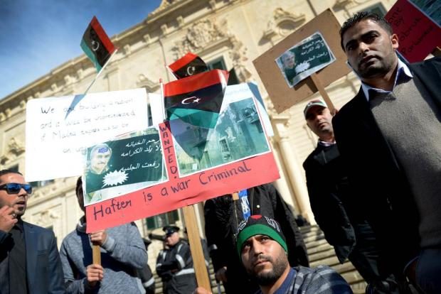 A group of Libyan demonstrators protest over the Maltese government's decision – which was guided by the United Nations and the EU – to recognise the chargé d'affaires representing the Tobruk-based Libyan government, outside Castille on December 29. Photo: Matthew Mirabelli