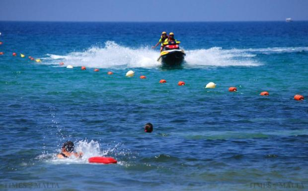 A jet ski speeds into Golden Bay during a demonstration of a rescue of a swimmer in distress in Ghajn Tuffieha on June 30. Photo: Mark Zammit Cordina
