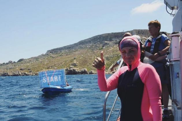 Michelle Muscat completes 14km charity swim