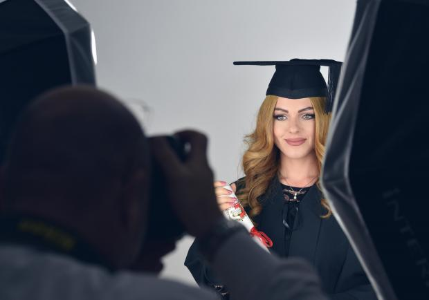 A graduate takes her graduation photo during a graduation ceremony at the University of Malta on November 21. Photo: Mark Zammit Cordina
