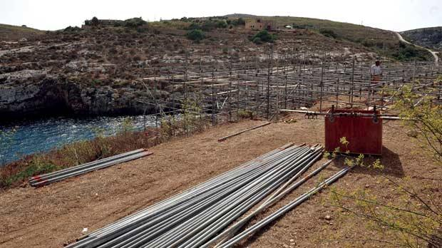 Scaffolding goes up at the picturesque Mġarr ix-Xini bay in Gozo in preparation for filming.