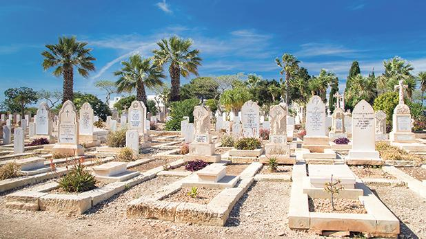 The naval cemetery in Kalkara where Pilot Officer John Southwell's gravestone (right) is found.